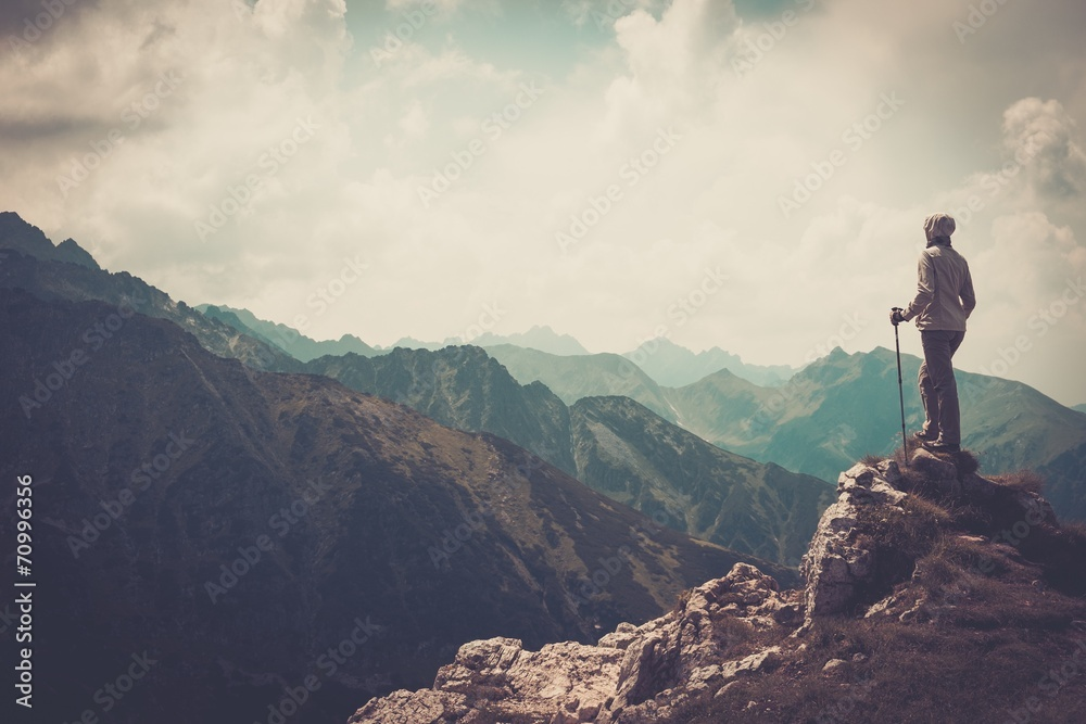 Fototapety, obrazy: Woman hiker on a top of a mountain