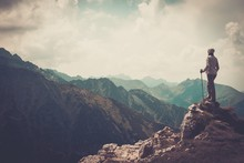 Woman Hiker On A Top Of A Moun...