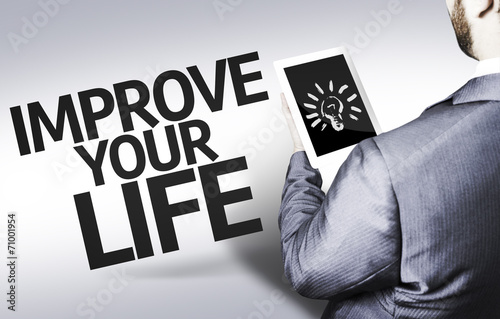 Valokuva  Business man with the text Improve your Life