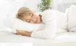 canvas print picture - Beautiful woman sleeping in white bed