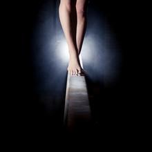 Feet Of Gymnast On Balance Beam