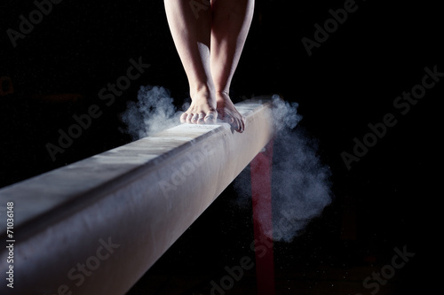 Photo feet of gymnast on balance beam