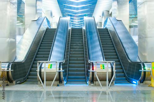 Obraz na plátně Moving escalator in the subway
