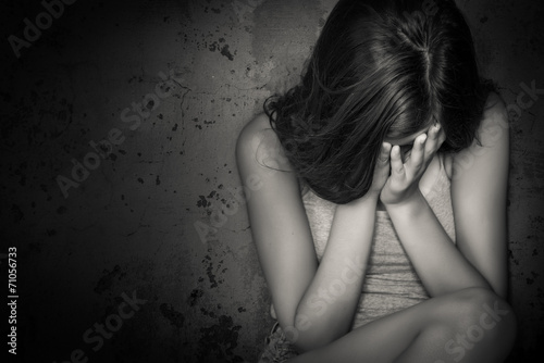 Fotografie, Obraz  Black and white grunge image of a teen girl crying