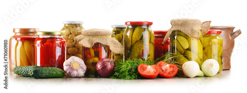 Fényképezés  Composition with jars of pickled vegetables. Marinated food