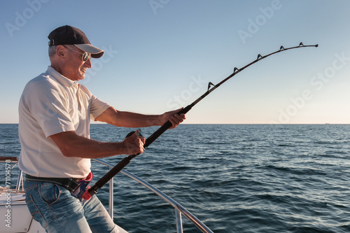 Foto op Canvas Vissen fisherman fishing from the boat