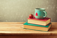 Christmas Tea Cup And Ball On Vintage Books