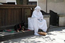 Street Performer And Dog Resting
