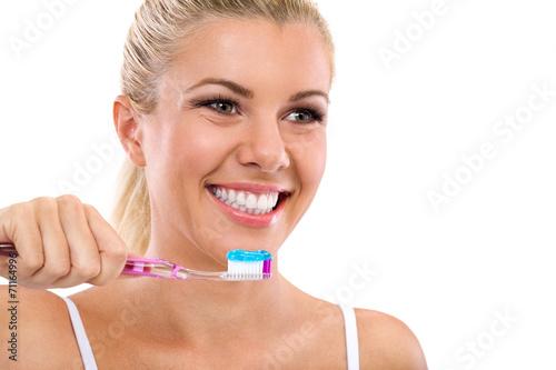 Valokuva  Beautiful girl brushing her teeth