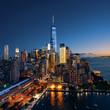 Leinwanddruck Bild New York City - colorful sunset over manhattan