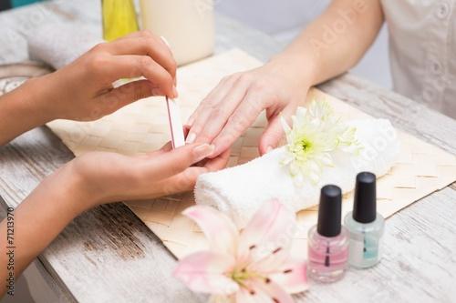 Staande foto Manicure Nail technician giving customer a manicure