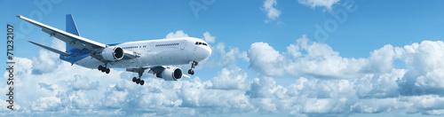 Türaufkleber Flugzeug Jet plane in a blue cloudy sky