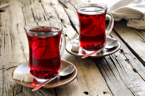 Photo sur Toile The Morning red tea with smartphone laying near by the cup