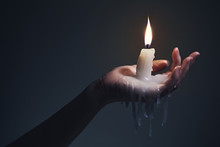 Holding A Candle On A Dark Bac...
