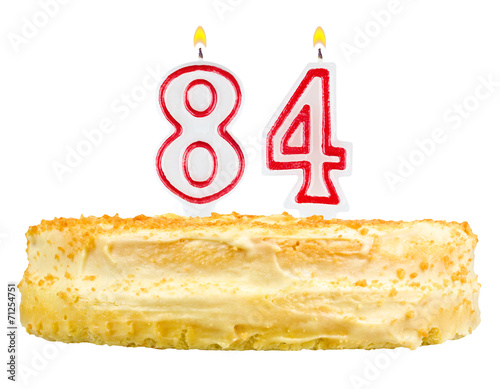 Fotografia  birthday cake with candles number eighty four isolated on white