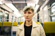 Beautiful young woman intimate portrait inside metro subway. Par
