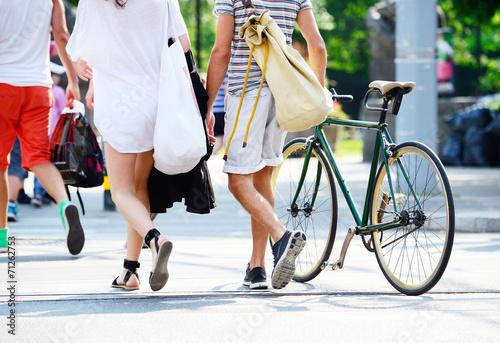 Deurstickers Fiets Couple walking with bike