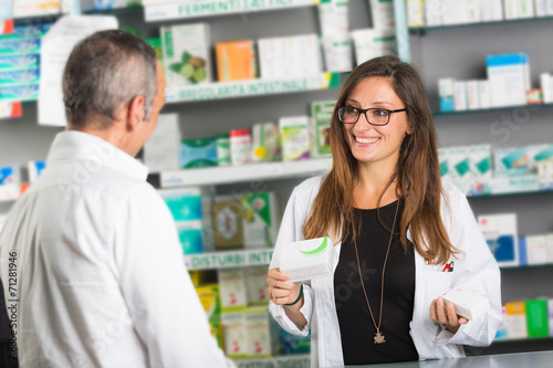 Keuken foto achterwand Apotheek Pharmacist and Client in a Drugstore