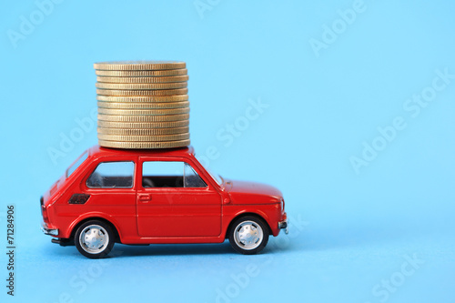 Fotografie, Obraz  Coins on red miniature car