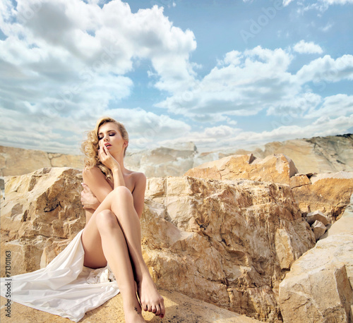 Fotobehang UFO Sensual blonde with the beautiful landscape behind