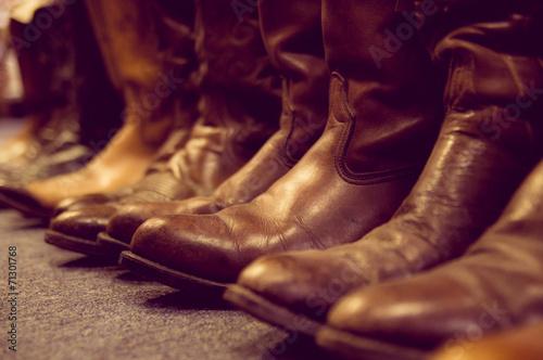 Fényképezés  brown leather boots