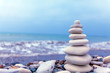 Pyramid of Stones near Sea on Beach