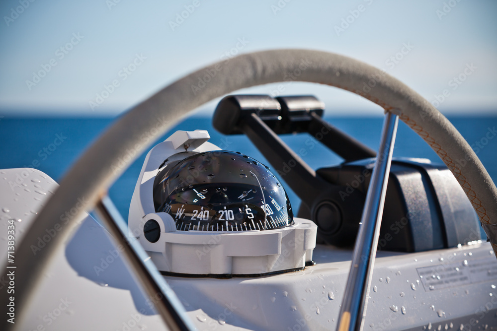 Photo  Sailing yacht control wheel and implement