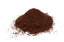 A Pile Of Ground Coffee Isolat...