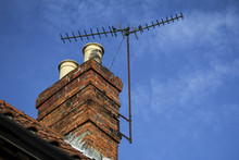 Chimney On A Roof With TV Aeri...