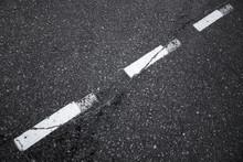 Black Asphalt Road Background With Striped Dividing Marking Line