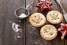 Christmas Fruit Mince Pies Over Rustic Wooden Background