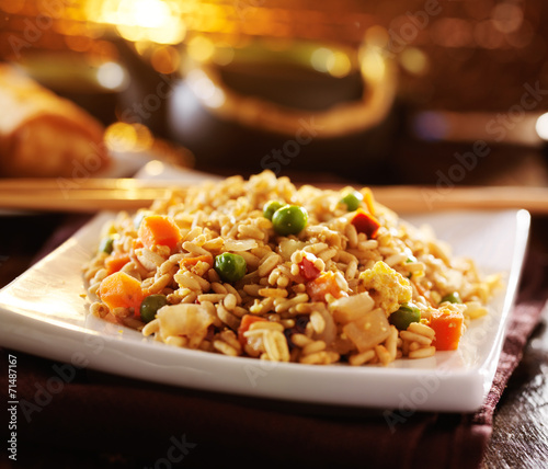 chinese fried rice on plate with orange glow Canvas Print
