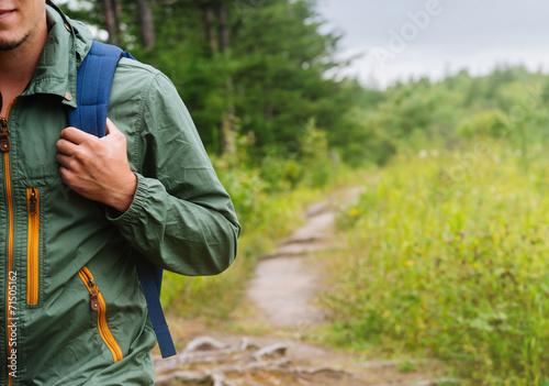 Hiker man walking on path in summer Fototapeta