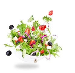 Fototapeta Do gastronomi Fresh salad with flying vegetables ingredients