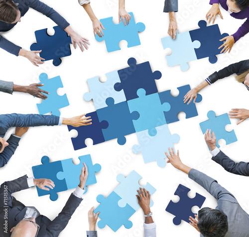 Fényképezés  Business People Piecing Puzzle Pieces