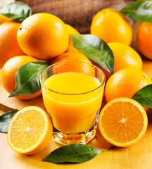 Fototapeta glass of orange juice with fresh fruits