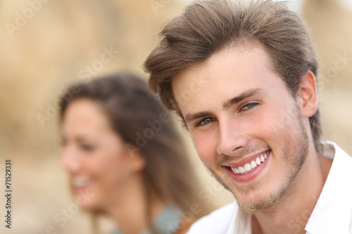 Valokuva  Handsome man portrait with a perfect white tooth and smile