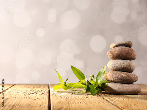 Autocollant pour porte Spa Spa stones and bamboo on wooden table on light background