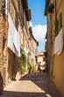 Italian style street decorated with flowers
