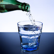 Pouring mineral water, closeup