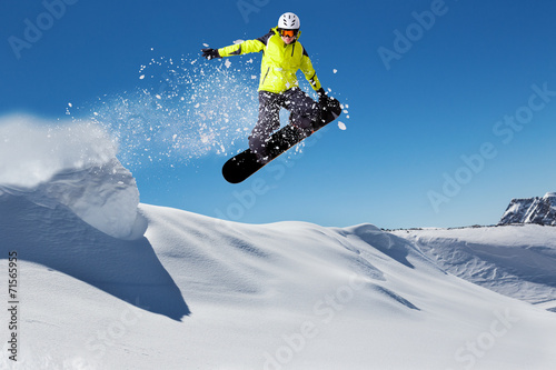 Fotografie, Obraz  Free rider on snowboard jumping from hill