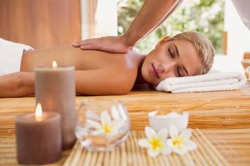 Obraz na płótnie Canvas Woman receiving back massage at spa center