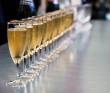 Row Of Full Champagne Glasses