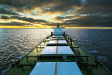 Cargo Ship Underway At Sunset