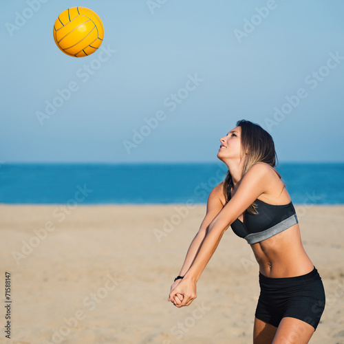 Attractive beach volleyball female player receiving ball. Tableau sur Toile