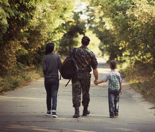 Family And Soldier In A Milita...