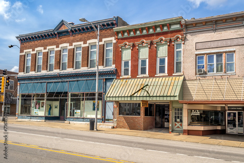 Photo  Ornate downtown shops and storefronts on main street in Midwest small town