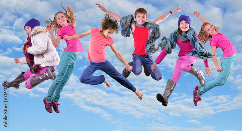 Foto op Plexiglas Dance School happy children exercising and jumping in the blue sky