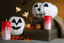 White Halloween Pumpkins And C...