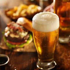 Fototapeta beer with hamburgers on restaurant table